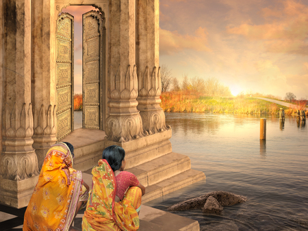 Women near a traditional indian door in the sunset.