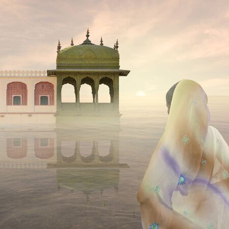 Woman with saree near a palace in the mist.