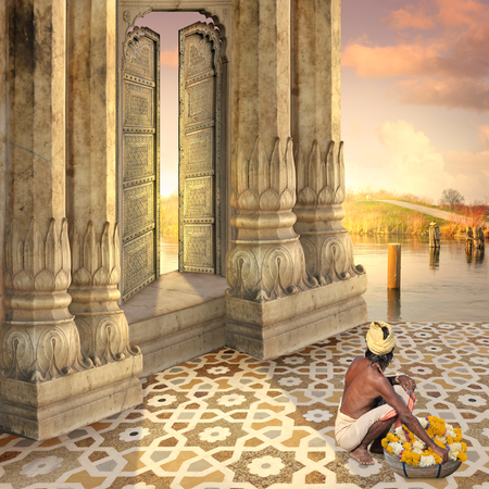 Man near a traditional indian door in the sunset. Stock Photo