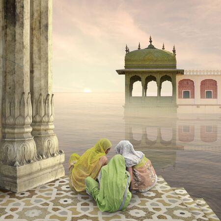 Indian women doing a hindu ritual in the mist.