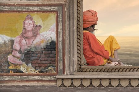 Holy indian man meditating on a window.