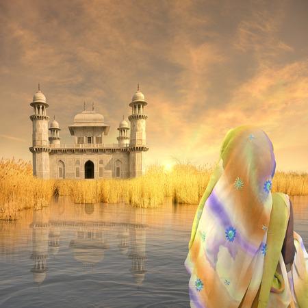 Woman with yellow saree near indian palace.