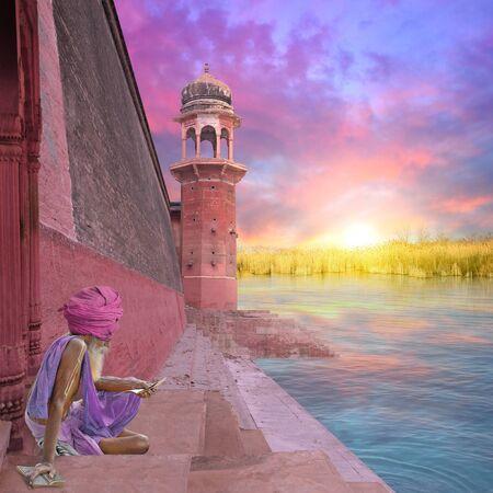 sadhu: Sadhu in the indian coast during the sunrise.