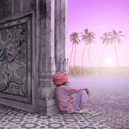 sadhu: Sadhu meditating in a temple during the sunrise.