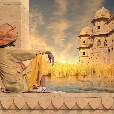 sadhu: Sadhu near indian towers on the Ganges river.