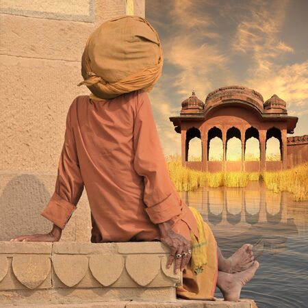sadhu: Indian sadhu near Ganges river in the sunset.