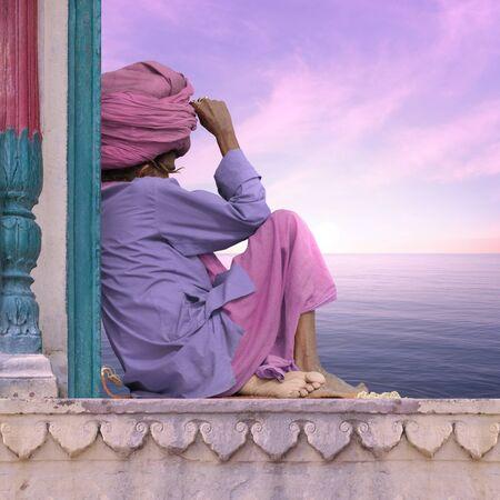 sadhu: Sadhu near indian coast during the sunrise.