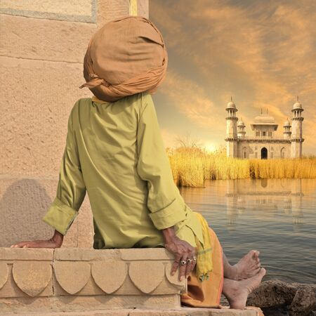 sadhu: Sadhu near Ganges river in the sunset.