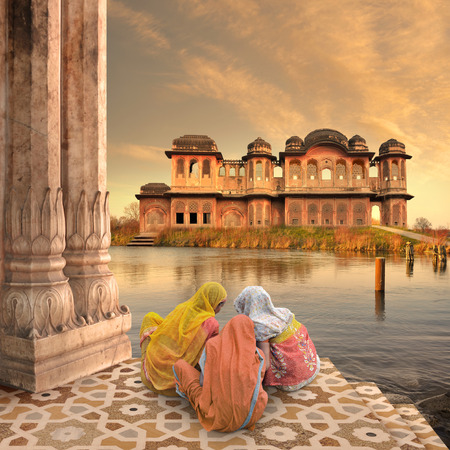 Women near traditional indian architecture on the Ganges. Stock Photo