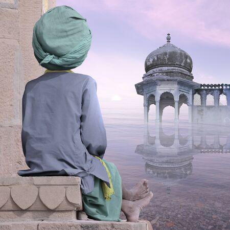 sadhu: Sadhu near indian coast in the mist. Stock Photo