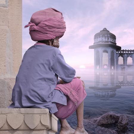 sadhu: Sadhu meditating near indian coast in the mist.