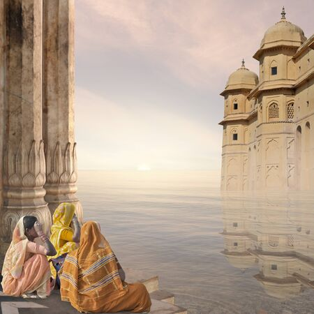Indian women near traditional architecture in the mist.