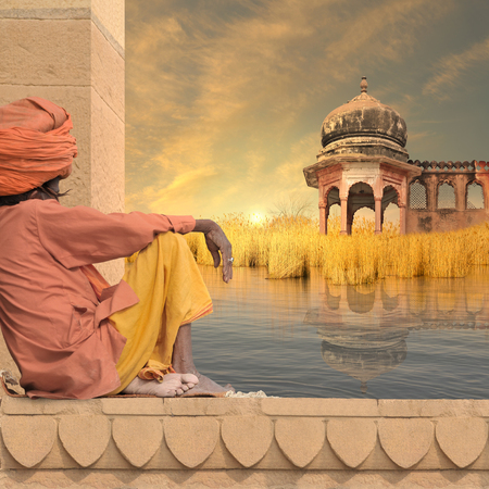 Indian senior near Ganges river during the sunset. Stock Photo