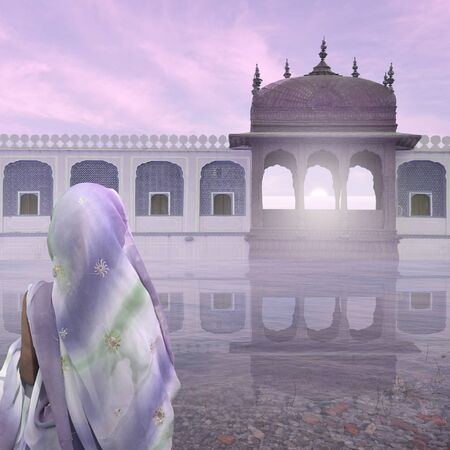 oasis at sunrise: Woman with saree near indian palace in the mist.
