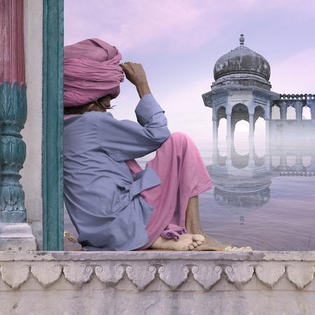 sadhu: Sadhu on a window during the sunrise in the mist.