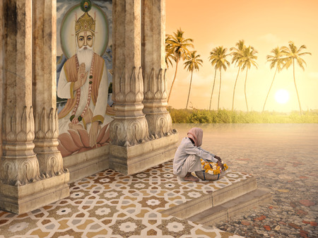 Indian man with flowers in a hindu temple.
