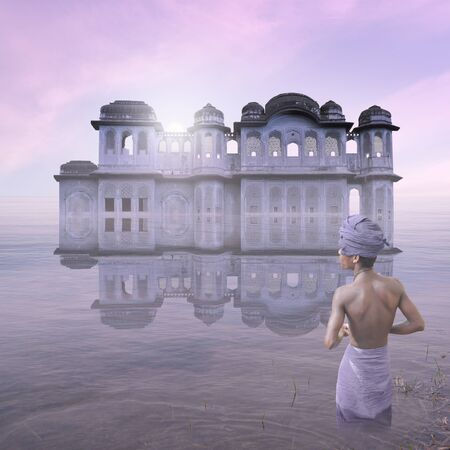 Traditional indian palace on the water in the mist.