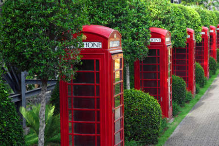 Many traditional UK red phone box in garden