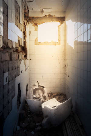 A shattered bathroom of an abandoned building Stock Photo