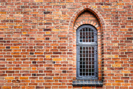 An ogival window in an old brick wall