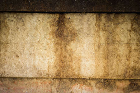 Detail of a dirty and stained surface in a derelict building