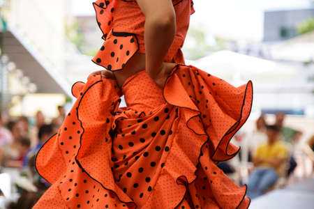 Close up of Little girl dancing Flamenco in Cordoba, Spain. Blurry background