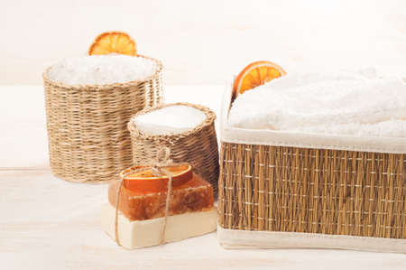 Accessories for bath on the white wooden background