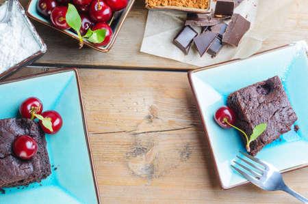 Chocolate cake - brownie - decorated with cherries Stock fotó