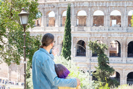 Father and dauther looking to Colloseum, Rome, Italy