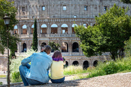 Father and dauther looking to Colloseum, Rome