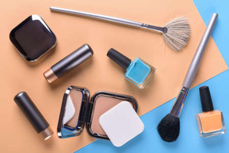 Flat view of cosmetics - lipstic, face-powder, brushes, nail polish Reklamní fotografie