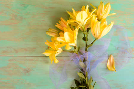 Close up of Lily flowers on the wooden background Stock Photo