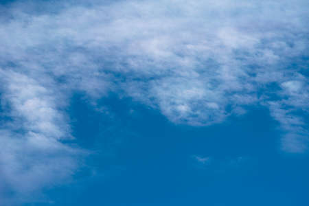 Abstract background with white clouds on blue sky