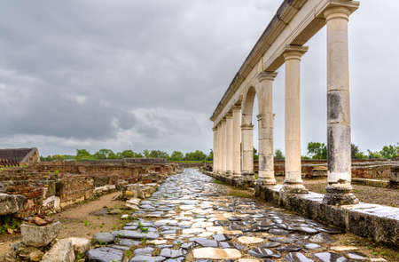 Landscape with ancient ruins and road in museum in Minturno, Italy. Stock fotó