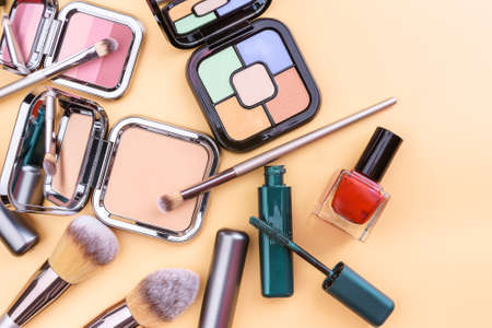 Flat view of cosmetics - lipstic, face-powder, brushes, nail polish Stock fotó