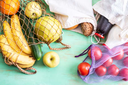 Organic food in reusable bags. Zero waste and low impact concept. Natural products free of synthetic gloss. Saving food trend