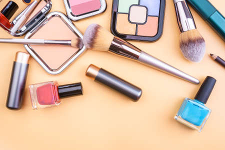Flat view of beauty products - lipstic, face-powder, brushes, nail polish Stock fotó