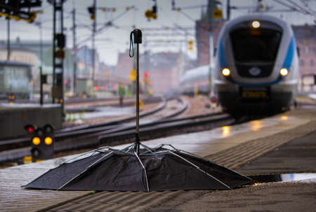 Broken umbrella on the train station