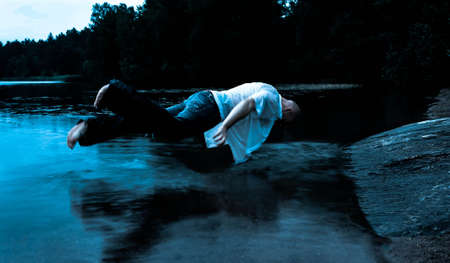 Levitating Sleepwalker over water photo