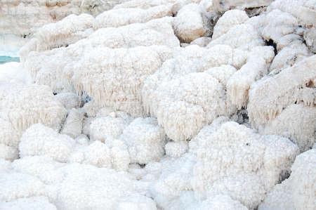 Dead Sea coast in Jordan, lumps of salt photo