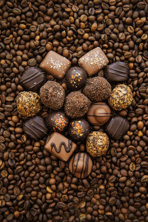 Chocolate heart on a background of coffee beans Stock Photo
