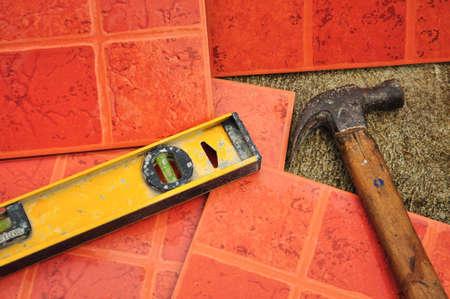 tiling background: Terracotta-colored ceramic floor tiles ready for paving