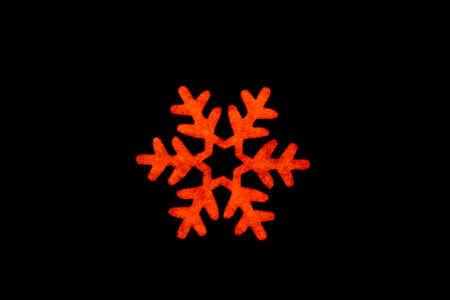 hum: Snowflake on background wood texture