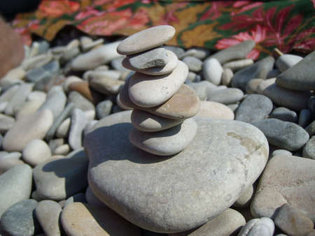 concretion: Pebbles on the beach with sea wave