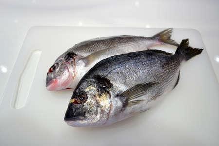 dorado fish: Dorado fish on the table chef