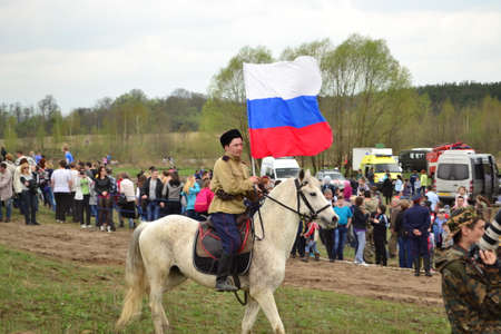 cossacks: Cossack riding a horse on the reconstruction of the battle of the Second World War Editorial