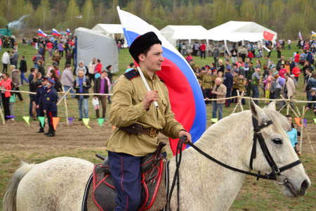 Cossack riding a horse on the reconstruction of the battle of the Second World War