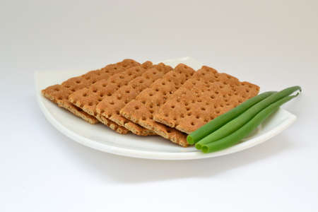 dietary: Dietary bread with green onion on white plate Stock Photo