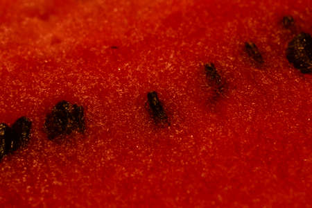 black seeds: Red ripe watermelon with black seeds Stock Photo