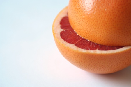 Fresh and detailed picture of blood orange cut in halves. Copy space.